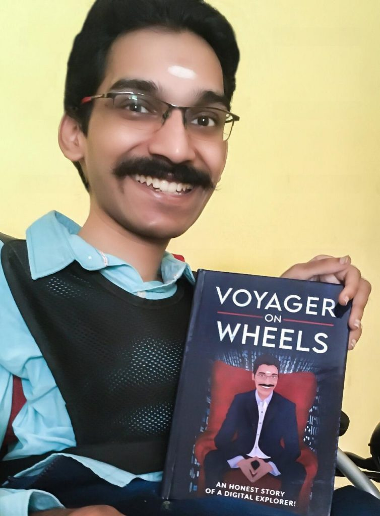 Muthu Krishnan with his Book